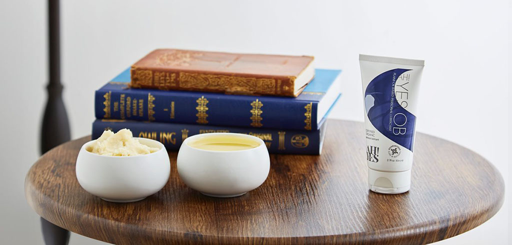 Photograph Of AH! YES OB On A Wooden Table Beside Two Bowls With Plant Oil Ingredients