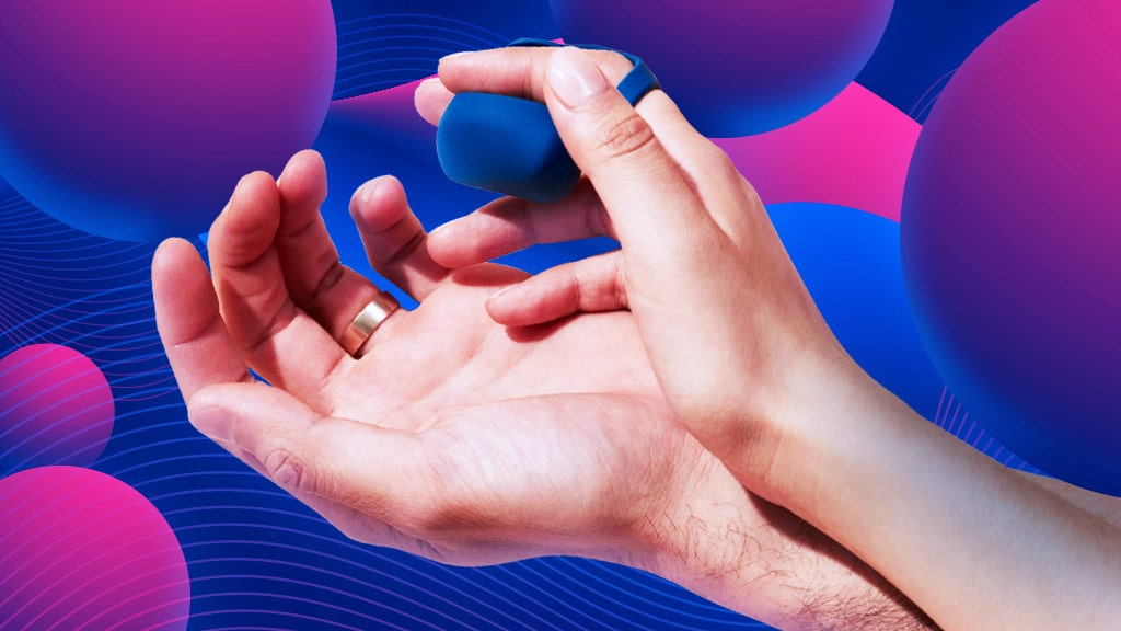 Woman's Hand Holding A Small Finger Vibrator And Leaning Against A Man's Hand, Playful Seduction Concept