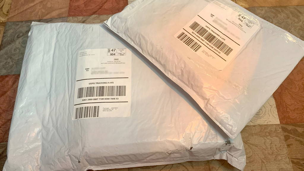 Photo Of One Large White Bubble Mailer With A Smaller Matching Mailer On Top, Depicting Discreet And Unidentifiable Packaging