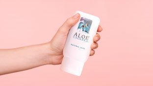 Photograph Of Hand Holding A Bottle Of Aloe Cadabra Personal Lubricant