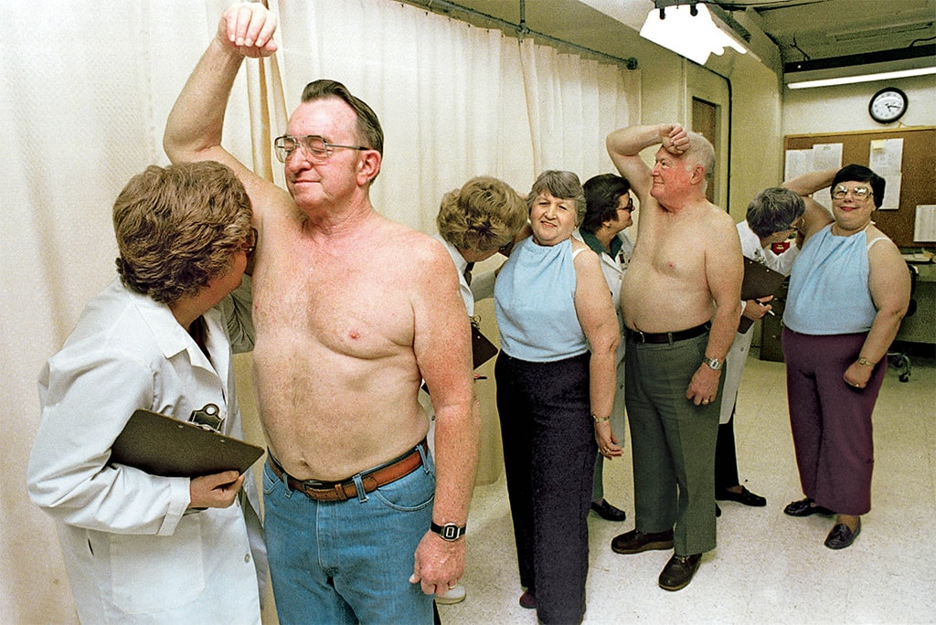 Photo Showing Men And Women With Raised Armpits And Experts Smelling Them To Assess Odor