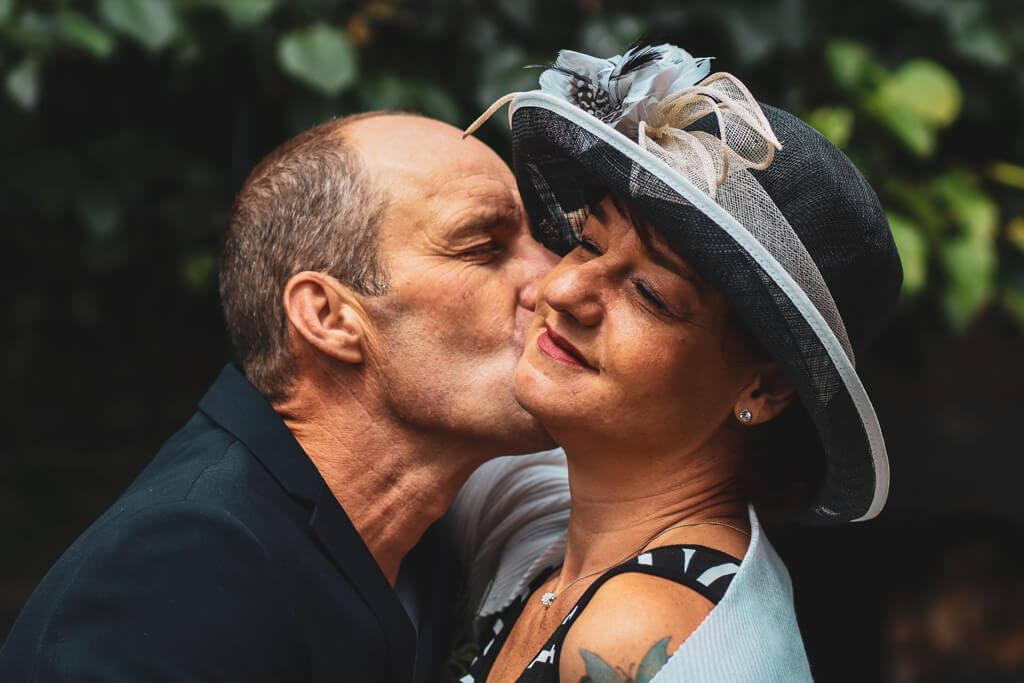 Happy Older Couple Man Kissing Woman's Cheek