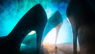 Surreal Concept, Silhouette Of Tiny Man Surrounded By Three Giant High Heel Shoes Against Bright Blue Smoky Light