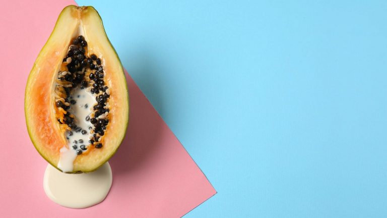 Half Of A Papaya With Dripping Cream Filled Center To Signify Cumming Inside A Vagina