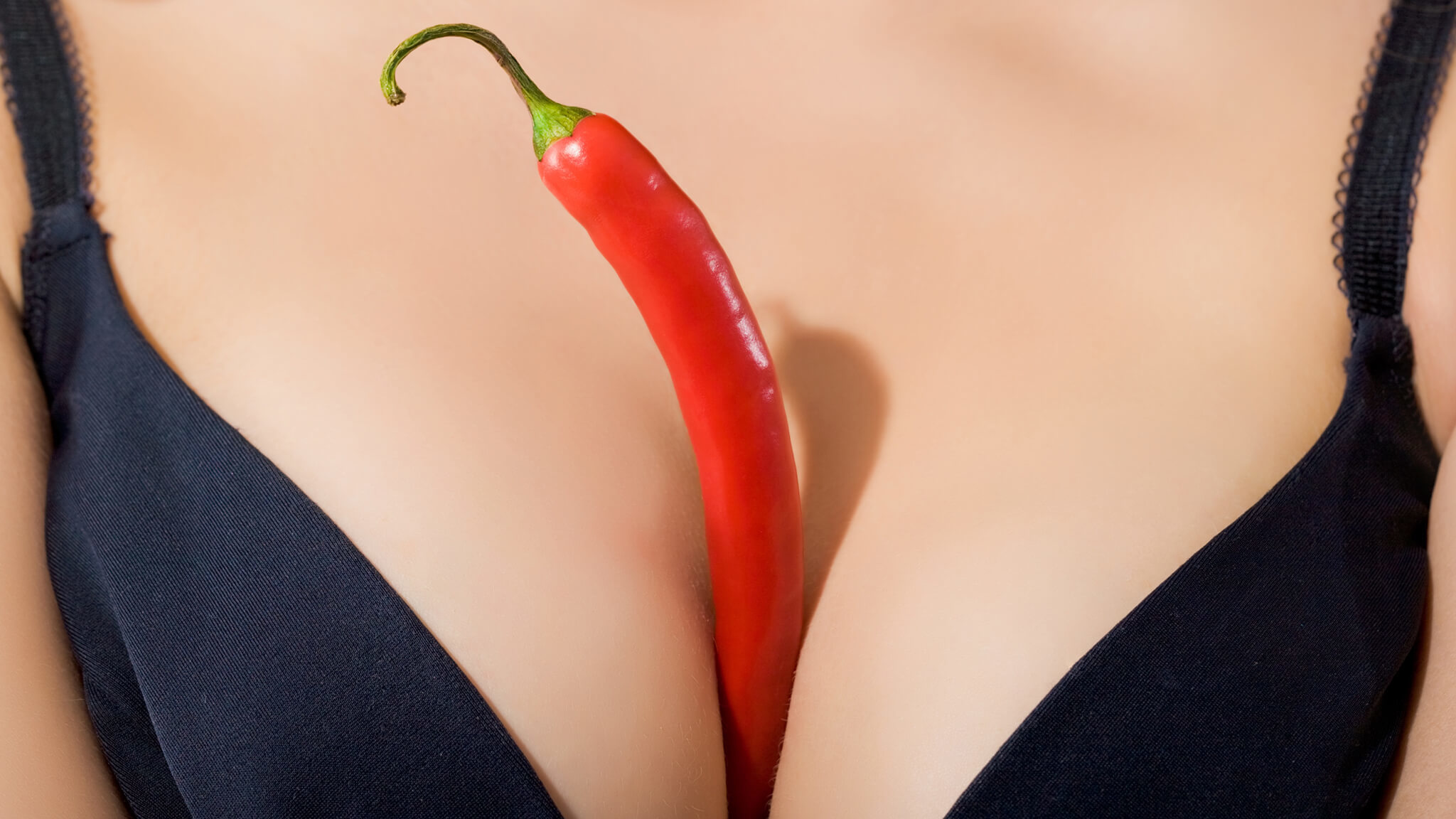 Image Of Woman's Breast Cleavage With A Pepper Between Signifying Breast Sex