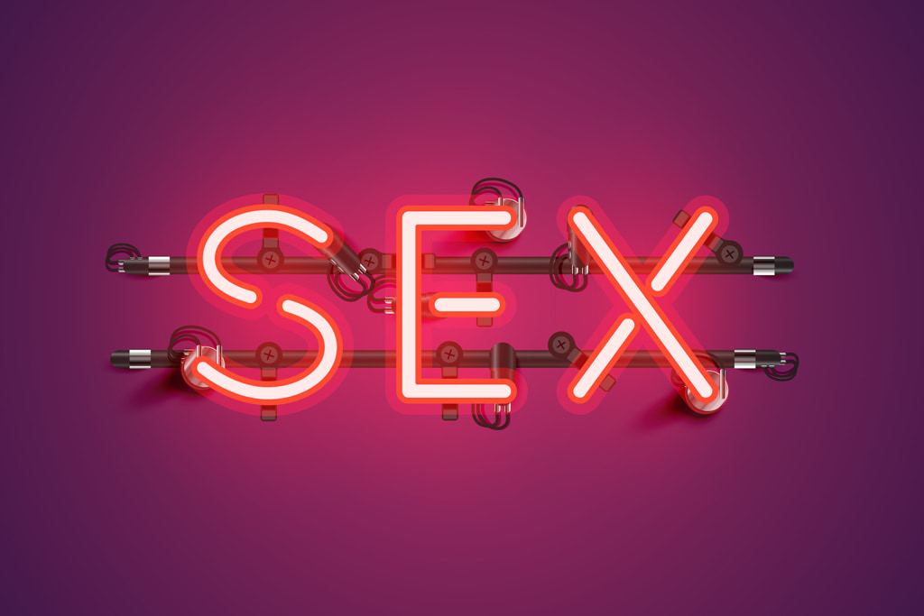 Red Neon Sex Sign On Plain Background