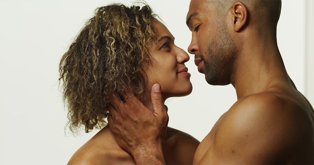 Black Couple Seductively Looking Into Each Other's Eyes About To Kiss