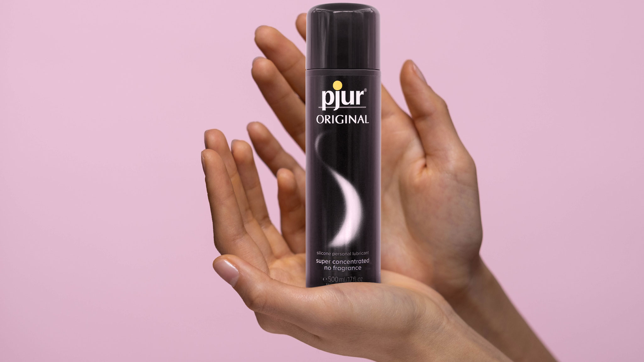 Photograph Of Open Hands Holding Bottle Of Pjur Original Silicone Lubricants