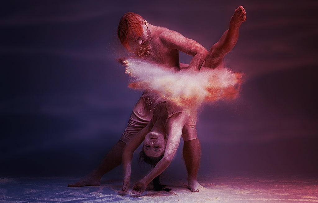 Photograph Of Dancers In Colorful Dust, Passion And Suspended Animation Concept