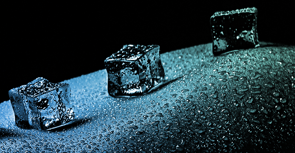Closeup Photograph Of Small Ice Cubes Along Wet Skin, Cold And Numbness Concept