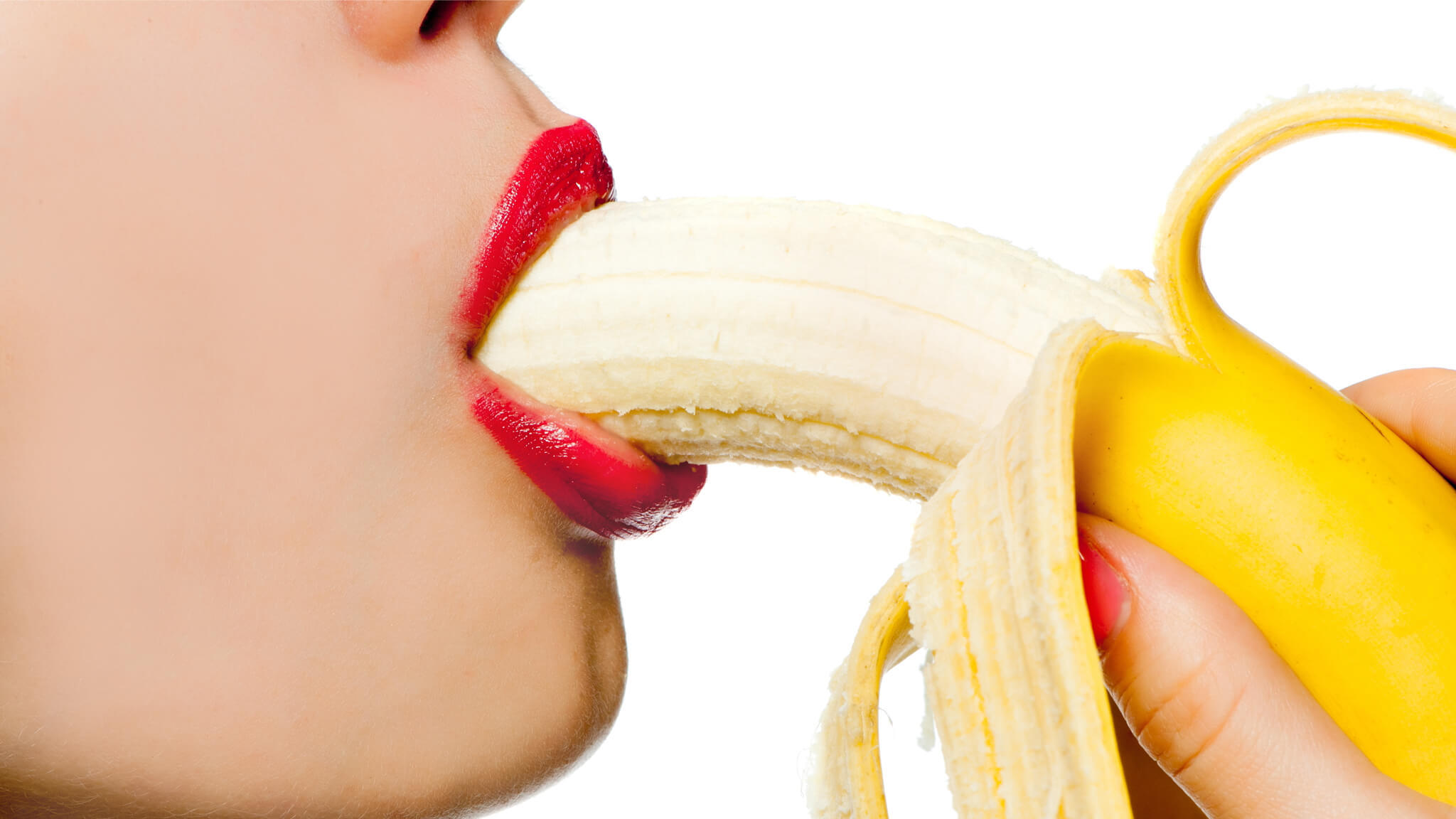 Woman Seductively Eating A Banana