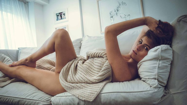 Woman Seductively Lying On A Couch
